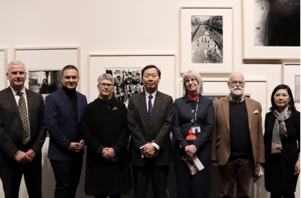 Group of seven people at Warfaring exhibition